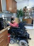 Monica at her kitchen